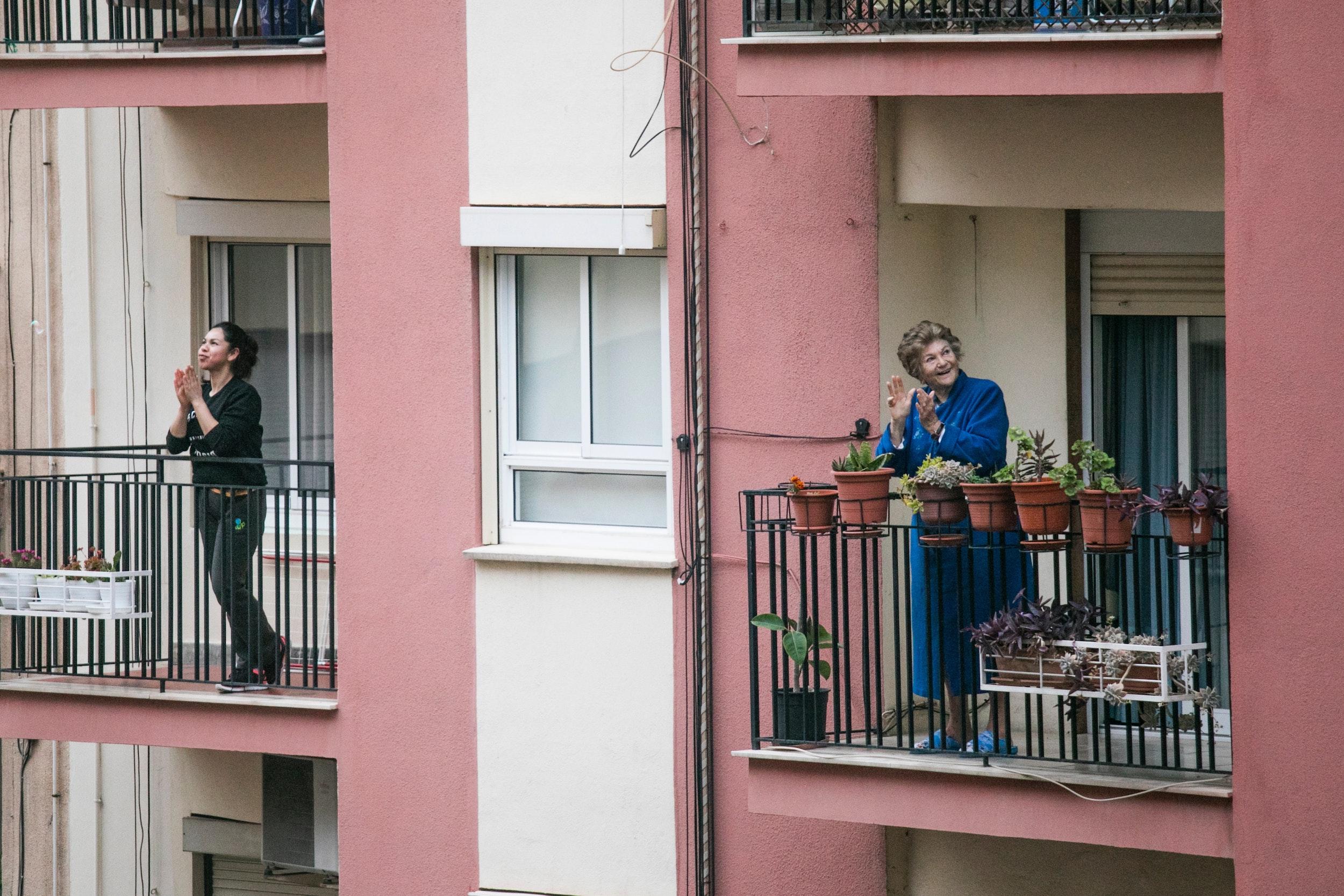 People cheering on balconies